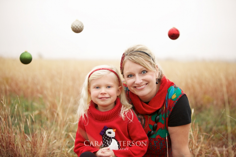 mom and daughter with christmas baubles