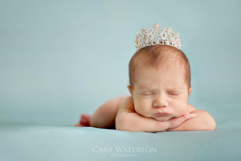 newborn on teal