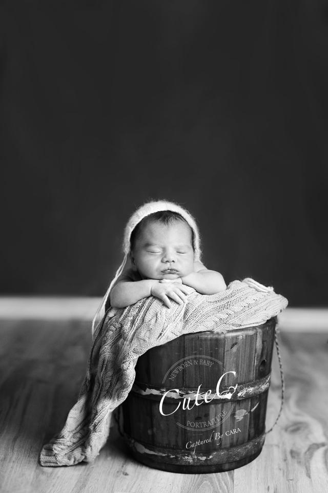 b&w newborn in bucket