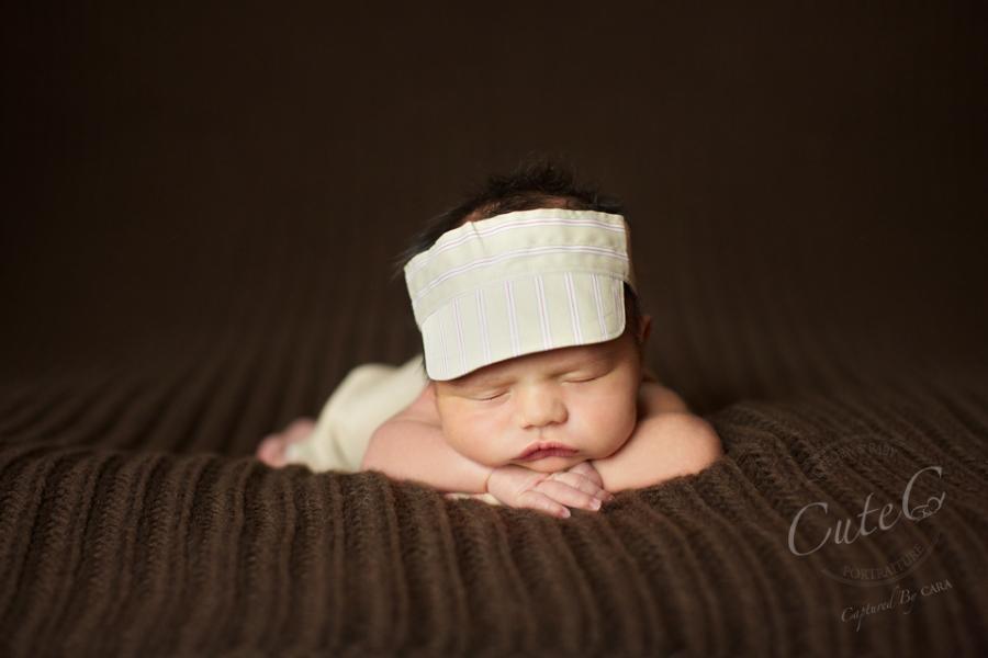 newborn on brown in visor