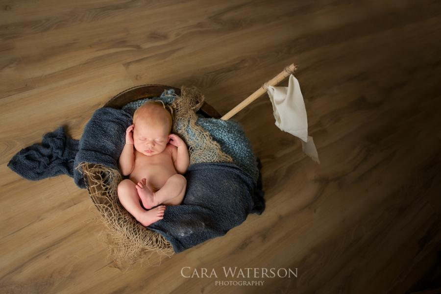 newborn in a tub boat