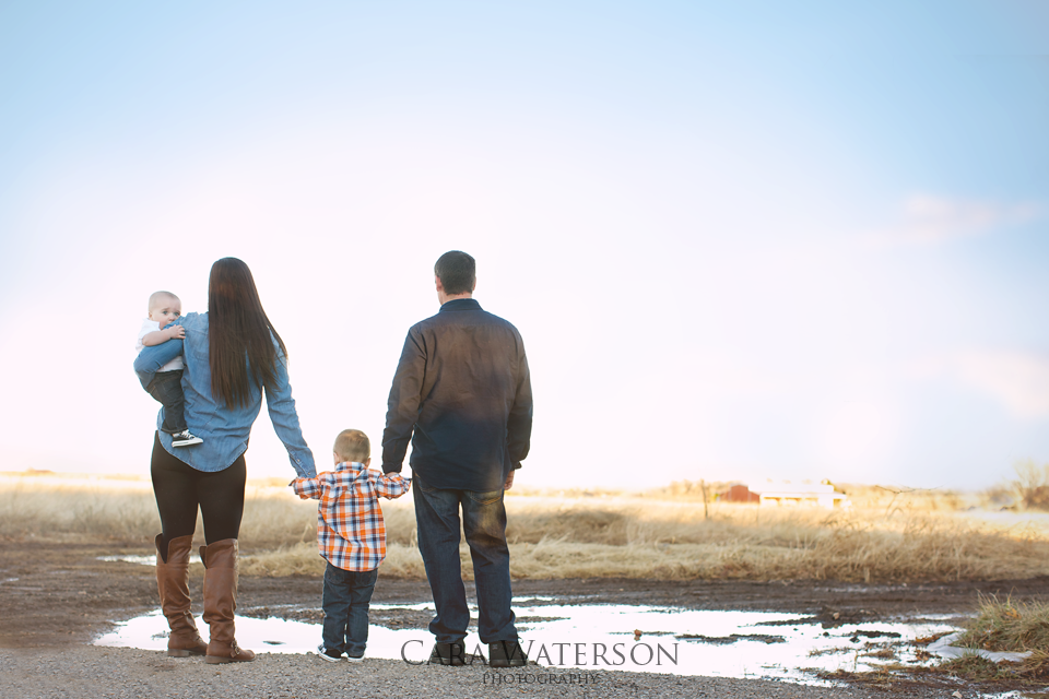 family gazing at the water