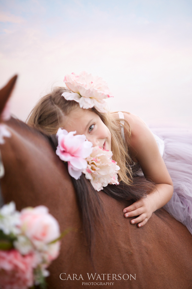 girl with horse and flowers