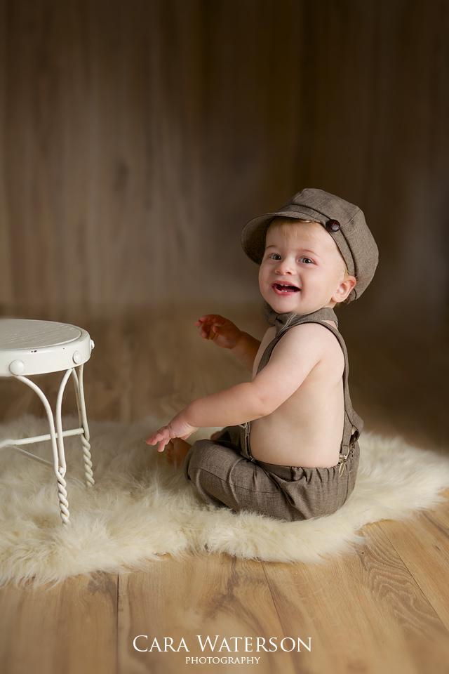 boy sitting in cap